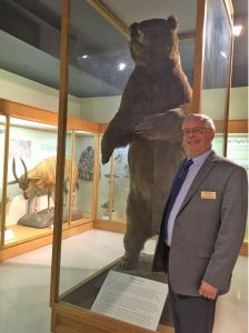 Image of Museum Director with Bear display
