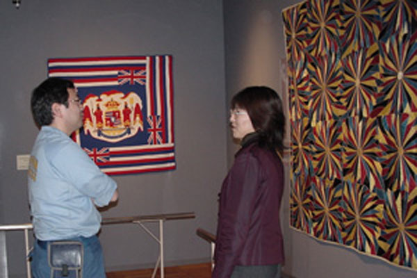 Image of the MSU Museum's Pinwheel Crazy Quilt