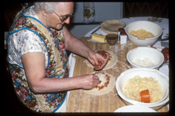 Image of Evelyn Makela assembles Cornish pasty. Photograph by Christine Saari, all rights reserved, Michigan State University Museum.