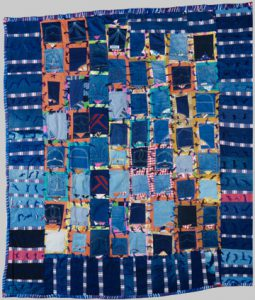 Photo of Blue Jean Pockets quilt made by Essie Lee Robinson in 1990.