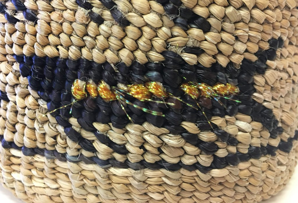 Detail of basket woven by Pat Courtney Gold