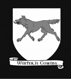 A fictional coat of arms. Coat of arms of House Stark. Shows a gray wolf on a white field. Underneath is a scroll bearing a motto: Winter is Coming. Attribution from Wikimedia Commons TenTonParasol [CC BY-SA 3.0 (https:// creativecommons.org/licenses/by-sa/3.0)]