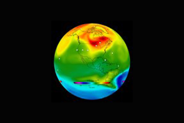 Globe overlaid with red, green, yellow, and blue colors to show carbon emissions