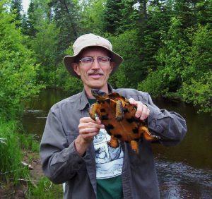 Jim Harding holding a turtle
