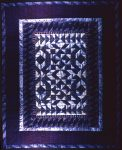 Dark blue and white quilt with geometric pattern
