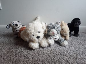 Five stuffed animals lying down
