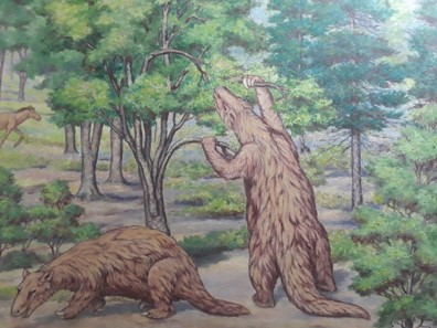 Painting of giant ground sloth reaching up into branches