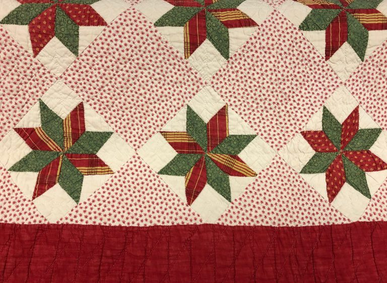 Close up of quilt with star pattern with border